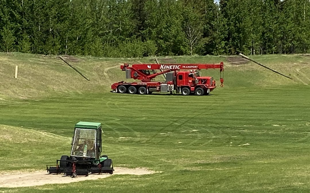 New driving range poles and netting being installed by Kinetic Transport.